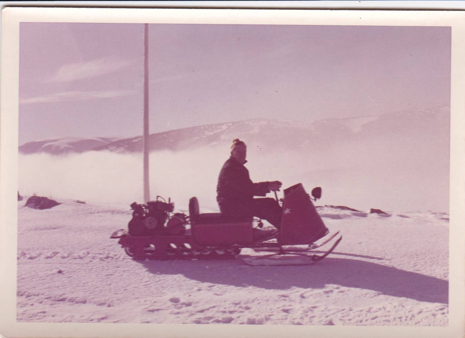 Dad above the clouds on his Polaris.jpg